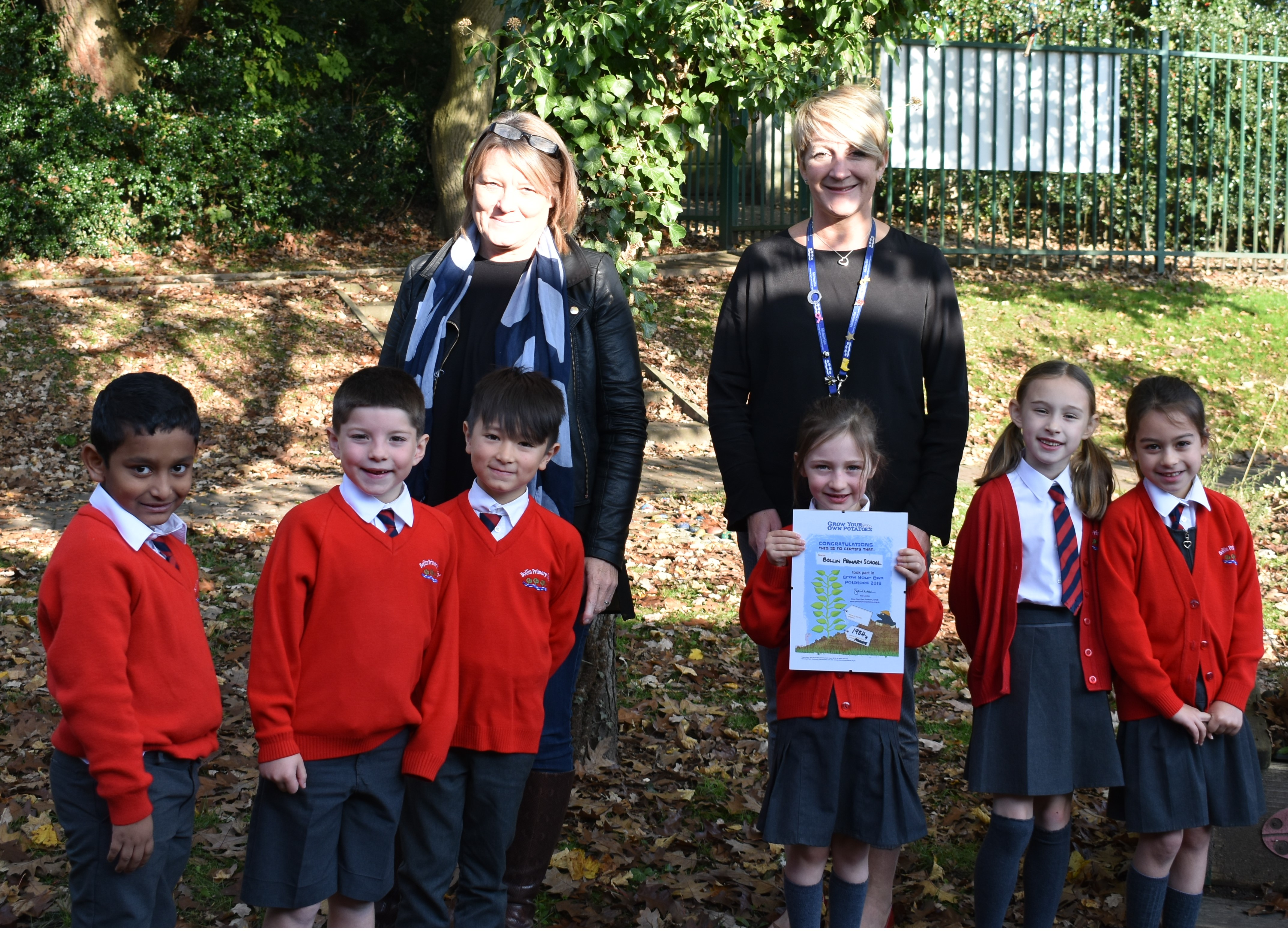 Pictured here on a lovely sunny day receiving their prize and winners certificate