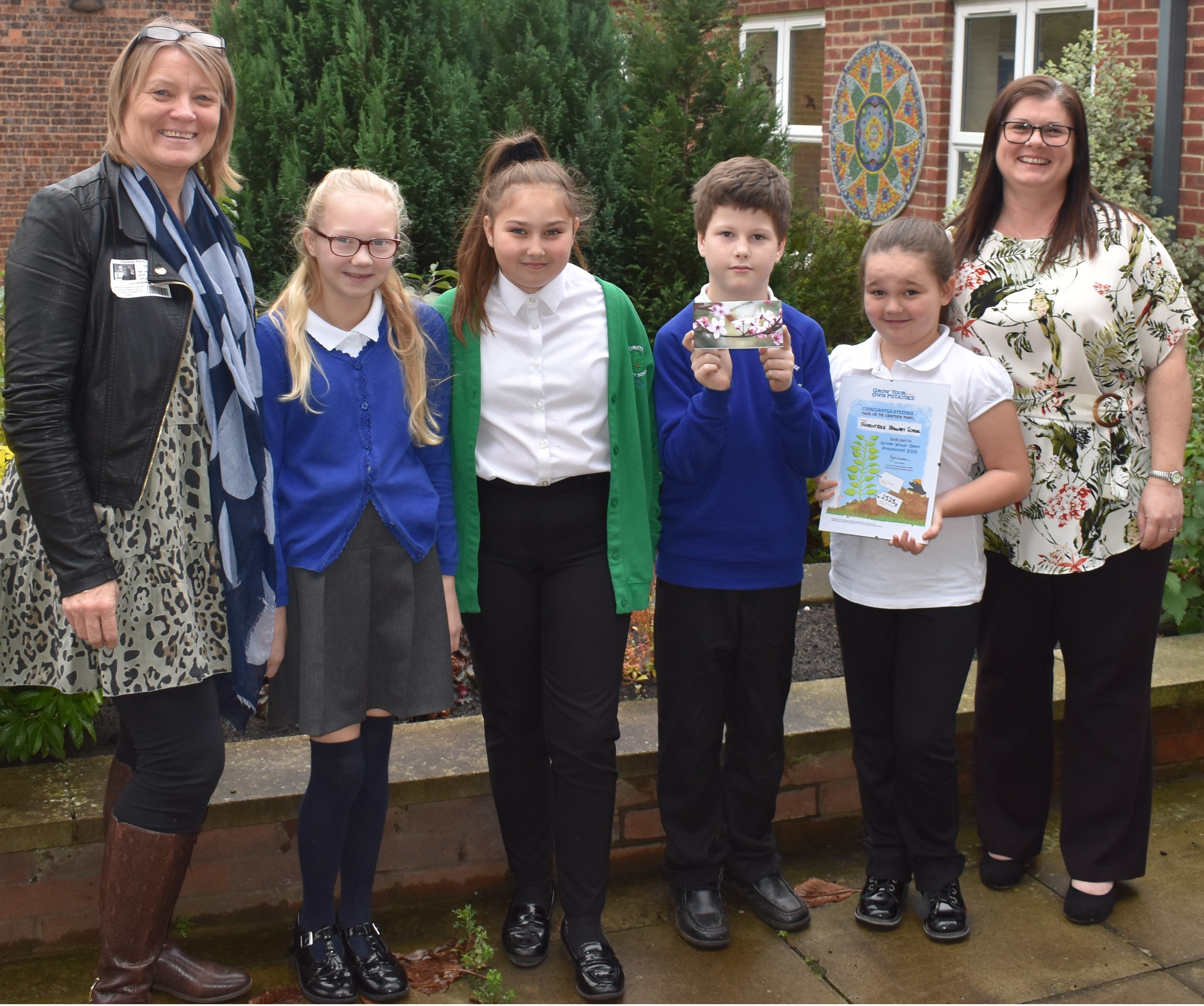 Pictured receiving their prize following a  whole school assembly